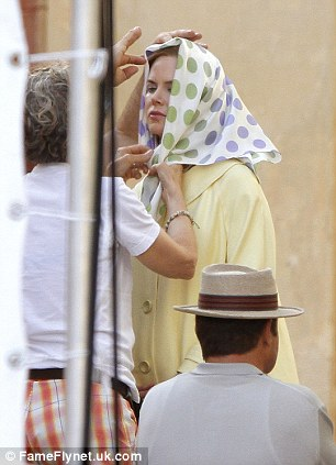 Highly-styled: Wardrobe assistants tied a polka dot headscarf onto the star