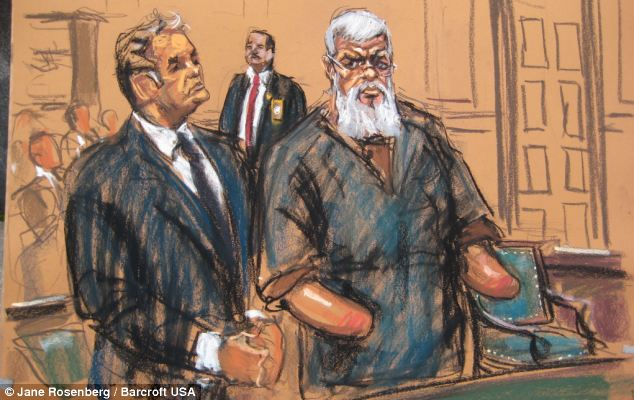 In the dock: Hamza, pictured with his lawyer Jeremy Schneider, pleaded not guilty to terror charges in a New York court last week
