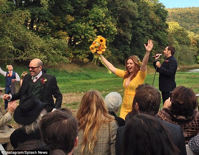 'This picture says it all': The twosome braved the great outdoors to swap vows in front of Amber's Sisterhood of the Traveling Pants co-stars Blake Lively, America Ferrera, and Alexis Bledel