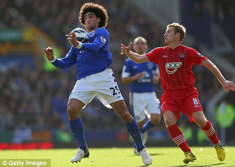 Missing man: Marouane Fellaini has been ruled out for three weeks with injury