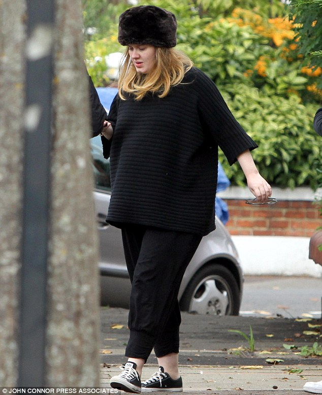 Keeping her head down: Adele seen a month before she welcomed her son with boyfriend Simon