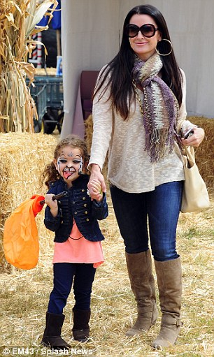 Lots of fun: The pair got festive as the little girl got her face painted