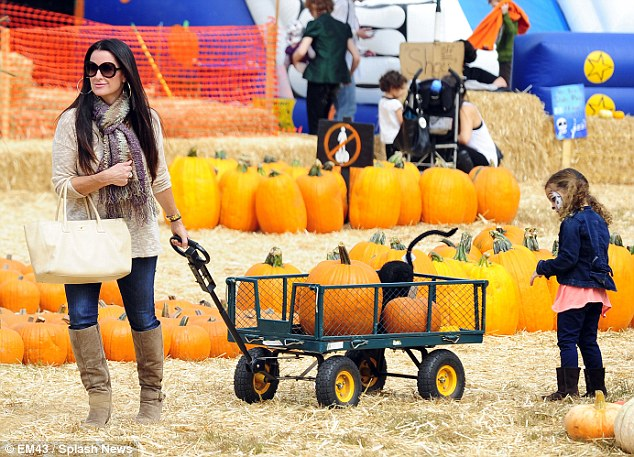 Carving time: The Real Housewives of Beverly Hills star lugged home two pumpkins
