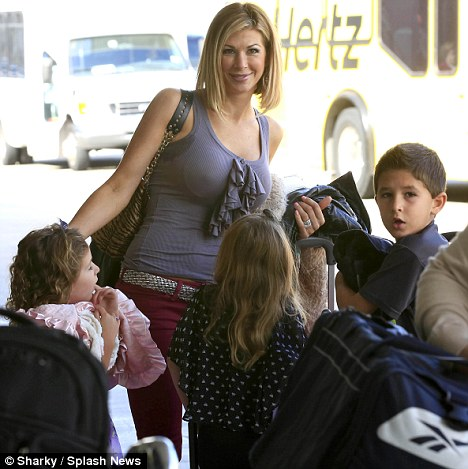 Doting mother: Alexis is leaving the show to focus on her family, including her three children (pictured here)