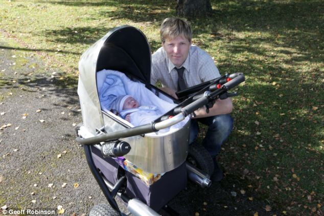 Colin Furze with Jake, his one month old son and the 50mph pushchair he built