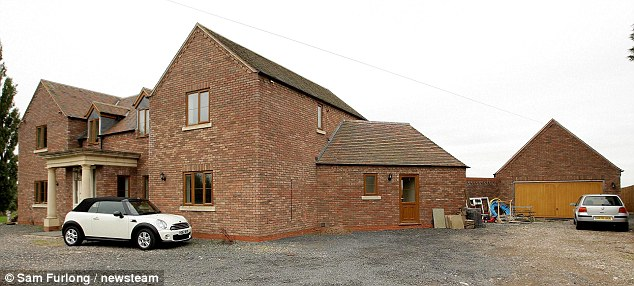 General view of 'Woodend' in the Worcestershire village of Lower Broadheath showing the front of the property with the garage on the right and the main house on the left