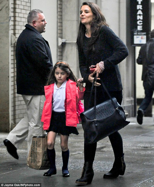 Tired: Suri Cruise arrives home with Katie at their New York apartment after a day at school on Tuesday