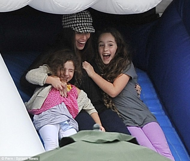 Joining in the fun: Punky Brewster actress Soleil Moon Frye took her daughters Poet and Jagger on the slide