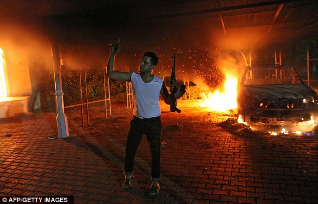 Rage: A protester hols his rifle during the assault on the Benghazi consulate