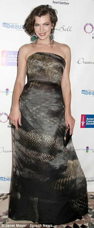 A far cry from last week! Milla looked like any other mother - but barely a fortnight ago looked sensational at a charity gala in New York