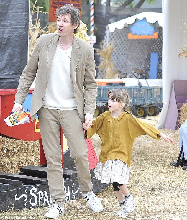 Family affair: Milla's husband Paul Anderson and four-year-old daughter Ever join the fun