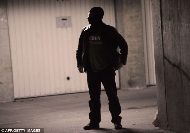 Protection: A policeman standing guard during the overnight operation in Torcy