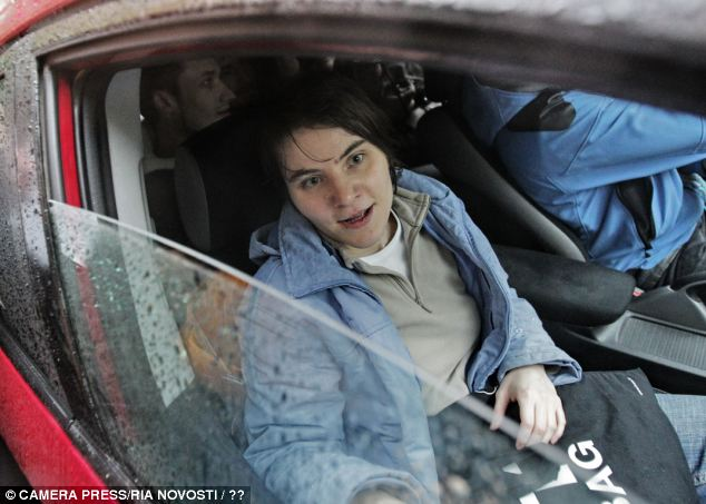 Released: As Samutsevich get in a car with her relatives, she can look forward to freedom whilst the other two members will serve their sentence at a penal colony
