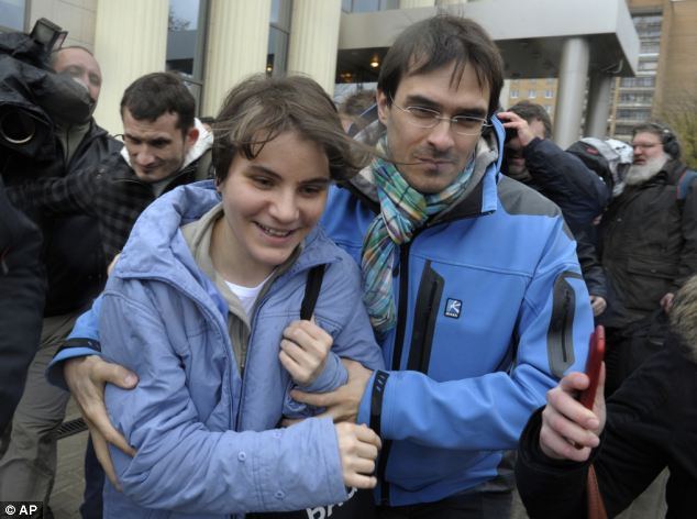 One free: Pussy Rioter Yekaterina Samutsevich is pictured leaving Moscow City Court after her sentence was suspended earlier today