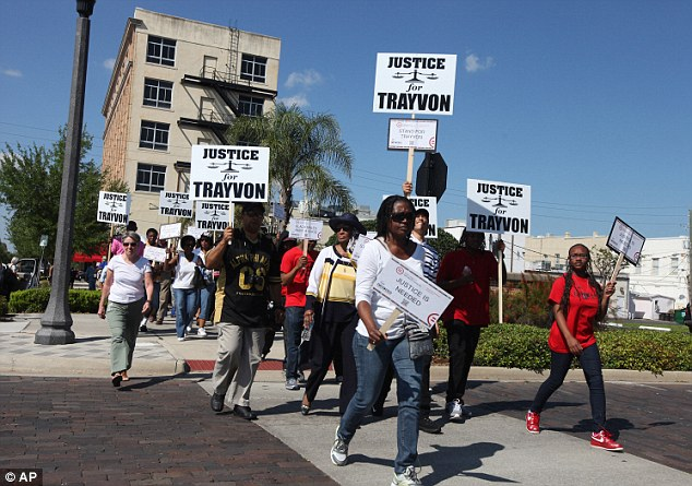 Fight: Attorneys for Zimmerman said the Twitter rant will not have helped their already troubled case. Here, supporters of Trayvon Martin hold a rally in March, calling for Zimmerman's arrest
