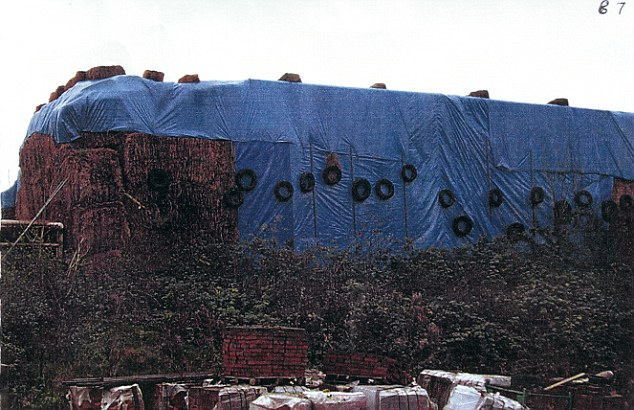 The 40ft stacks of hay bales covered by a huge tarpaulins, which conceal the mock Tudor castle