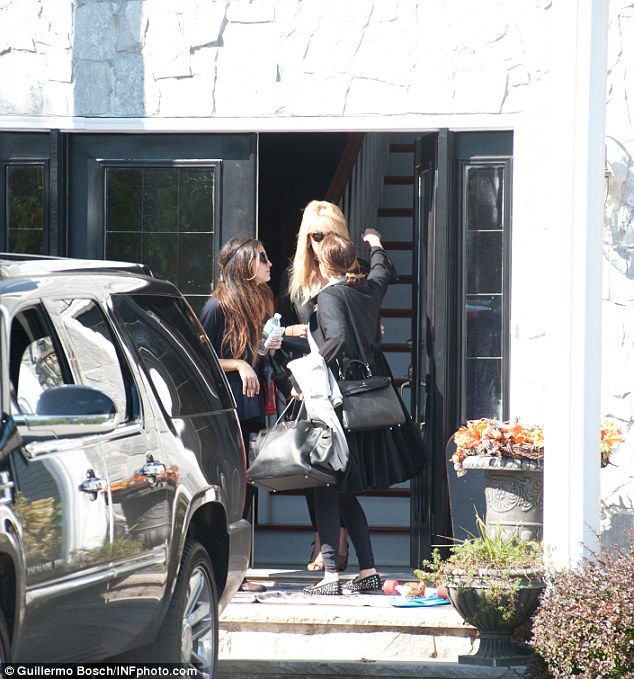 Over the drama: Dina and Lindsay seemed to have moved past their feud as the actress prepared to embark for Los Angeles on Thursday