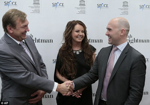 On a space mission: British soprano Brightman, pictured centre, with the Russian Space agency Head of Human Space Flight Programs Aleksei Krasnov, left, and Space Adventures CEO Eric Anderson