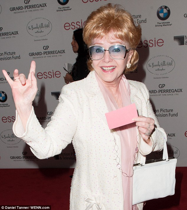 Young at heart: Debbie offers a wave at the BMW Beverly Hills Hotel Event in Los Angeles in June