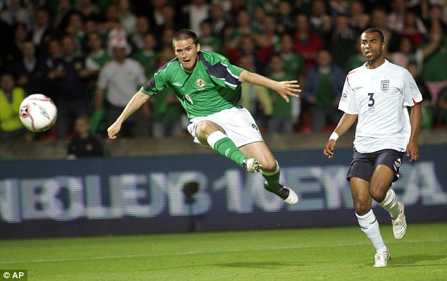 Flying start: David Healy fires in the winner as Ashley Cole looks aghast