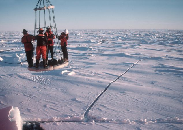 Taken in March 2003, this image shows four British Antarctic Survey scientists being retrieved from research on sea ice in the Antarctic using a buoy.