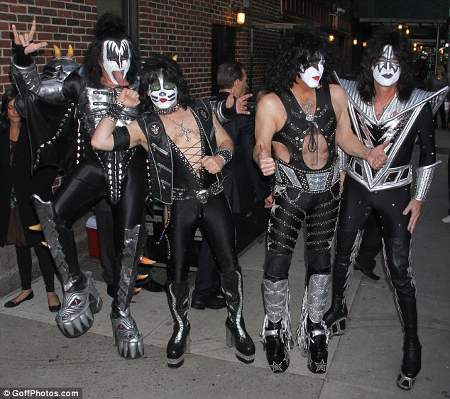Rock on: Iconic metal group Kiss arrive for a live performance on GMA on Thursday morning in New York