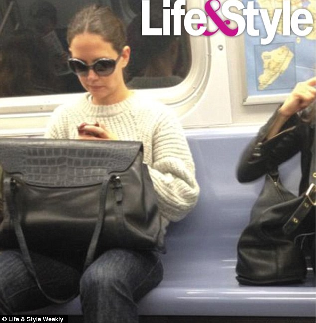 Saving your pennies on a chauffeur: Katie Holmes hops on the subway - trying to go incognito in shades and casual clothes