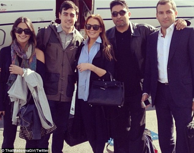 'I just want to work': Lindsay was pictured in a photo posted to Twitter on Thursday about to board a plane bound for Los Angeles, where she is scheduled to attend a promotional event