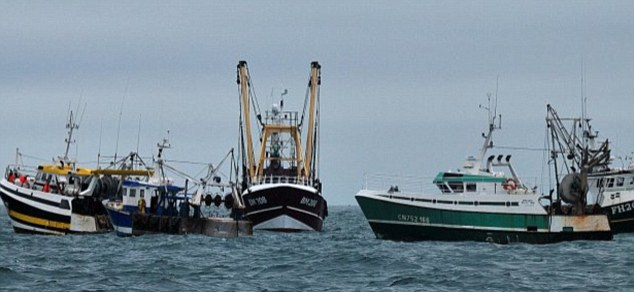 Anger: French trawlers confront the larger British trawler, in the centre of the picture,  during the standoff  La Manche Libre