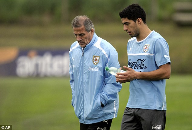 Back home: Luis Suarez (left) in training with the Uruguay squad in Montevideo
