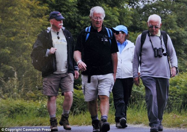 Fit: Peter Fleming, right, and his hiking friends. He experienced discomfort in his chest which made him go to see his GP