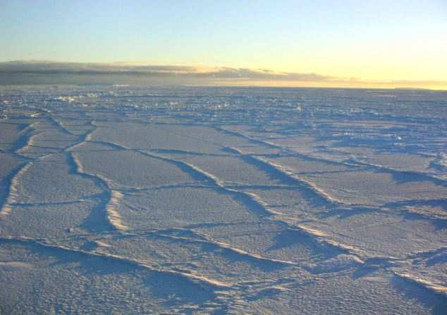 Antarctic sunlight illuminating the surface of the sea ice in 2003, intensifying the effect of the fracture lines.