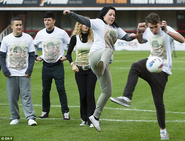 Ball crazy: Lucy Spraggan looked a tad scared as she kicked the ball