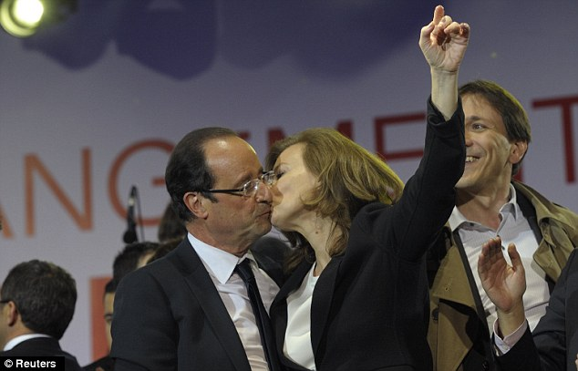 Victoire: Francois Hollande celebrates his election win with Valerie Trierweiler earlier this year. She has since become one of the most unpopular first ladies in recent history