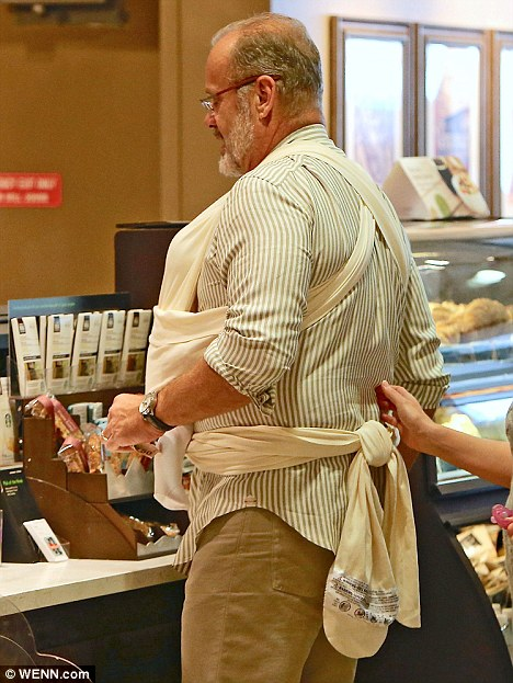 Complicated: The sling wrapped around the new father's entire body