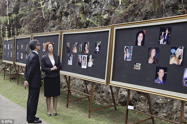 Photos: Australian Prime Minister Julia Gillard is accompanied by Indonesian Foreign Minister Marty Natalegawa as she looks at pictures of victims on display at the Garuda Wisnu Kencana cultural park in Jimbaran, Bali