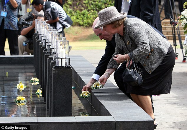 Poignant: Former Australian Prime Minister John Howard and his wife Janette Howard lay flowers at a memorial pond. 88 of the 202 victims were from Australia