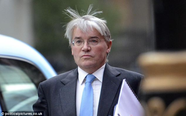 Chief Whip Andrew Mitchell arrived for work by car yesterday and made his way into No10 by a side door