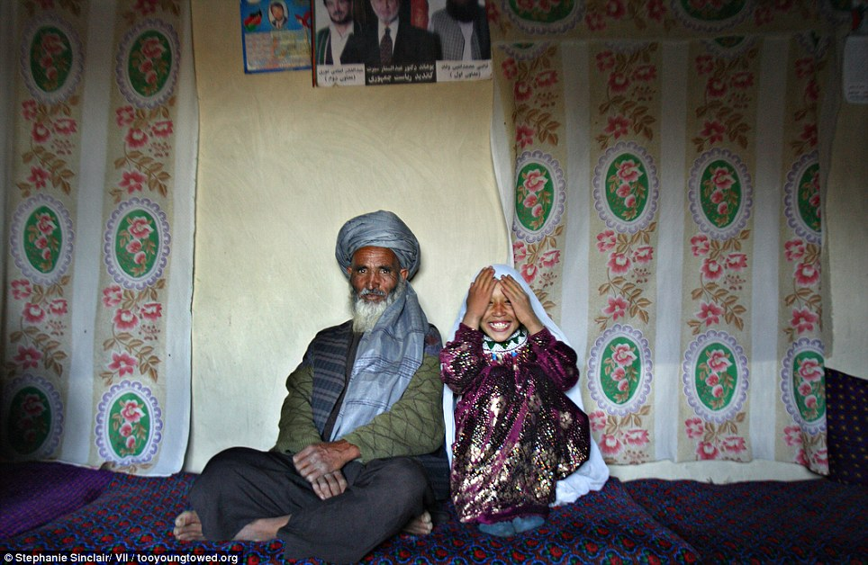 Shocking: Portrait of Said, 55, and Roshan, 8, on the day of their engagement, Afghanistan