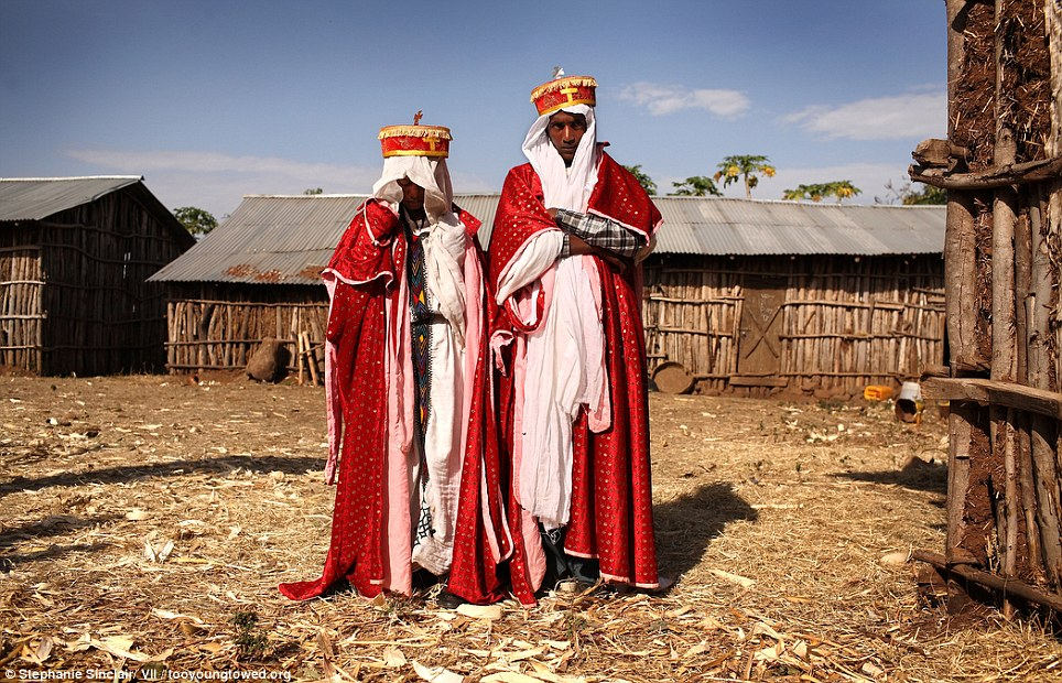 Opulent: Priest Addisu Abebe, 23, and his new bride Destaye Amare, 11, are married in a traditional Ethiopian Orthodox wedding in the rural areas outside the city of Gondar, Ethiopia