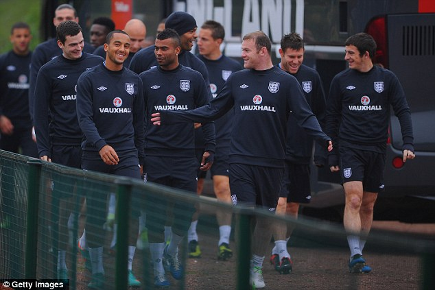 Armband: Wayne Rooney (front right) has been given the captaincy
