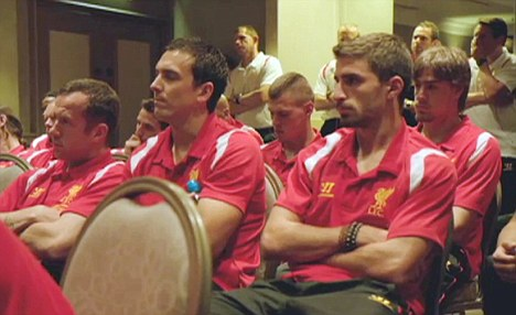 Dubious: The Liverpool players look a bit underwhelmed by the idea