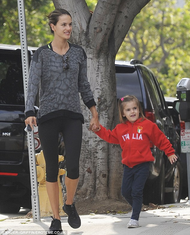 Back to mummy duties: Alessandra was seen taking daughter Anja to school in her cropped leggings and make-up free