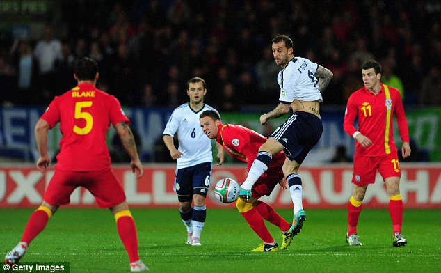 Welcome back: Steven Fletcher marked his return to the Scotland side with a brilliant assist in the first half