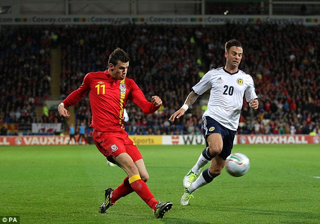 Lively: Gareth Bale had an energetic game up against Danny Fox (right)
