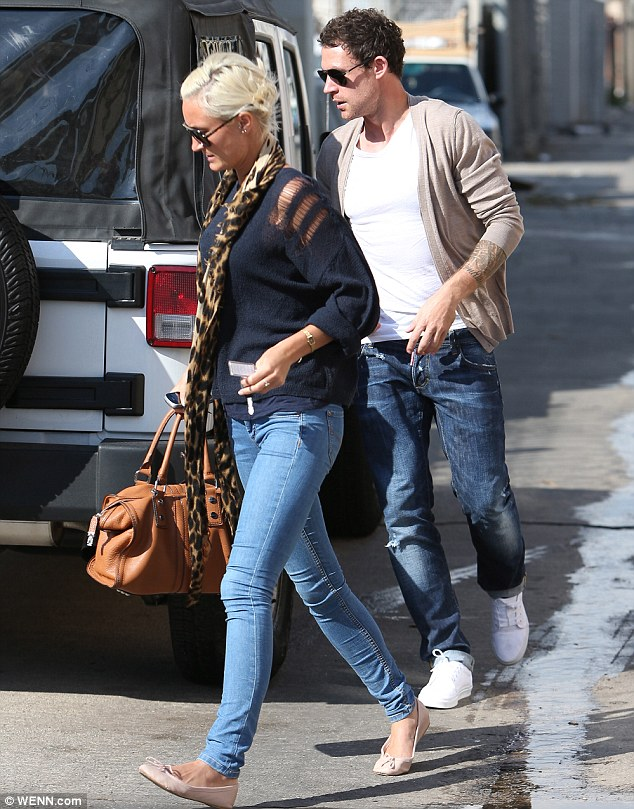 Family time: Wayne was also seen giving Frankie's sister Victoria a hand with her suitcase, taking it down the stairs for her before helping her with it to her waiting car