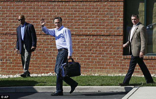 Hunkering down: Republican presidential candidate and former Massachusetts Gov. Mitt Romney is accompanied by U.S. Secret Service agents as he emerges from debate preparation at a hotel in Columbus, Ohio