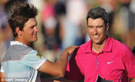 Leading the pack: Bernd Wiesberger (left) leads Ross Fisher in Portugal