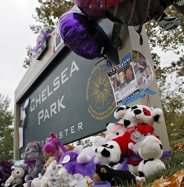 Missed: A sign at the park where Jessica was supposed to meet her friends to walk to school is adorned with stuffed animals and balloons