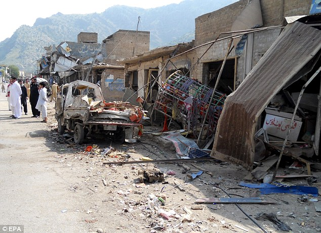 Rubble: Forty people were also injured in the blast that destroyed numerous shops and cars